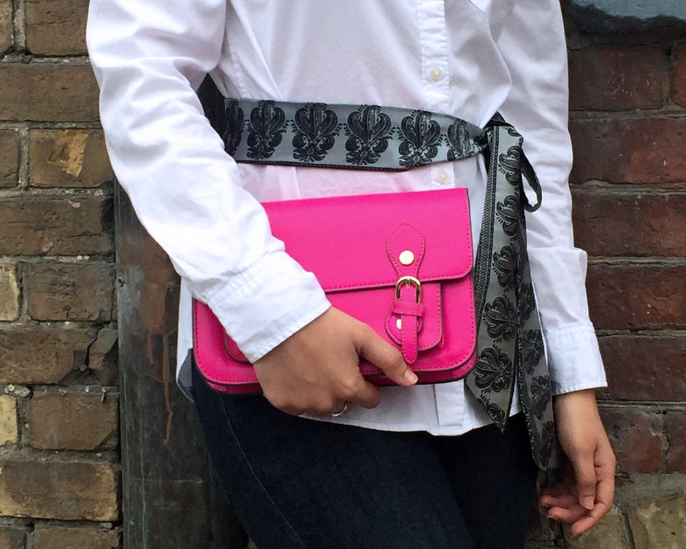 close up of fuchsia clutch