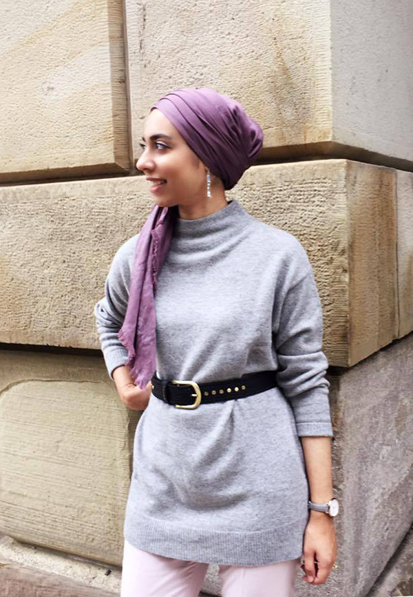 Fall accessories include a belt over sweaters to cinch in waist
