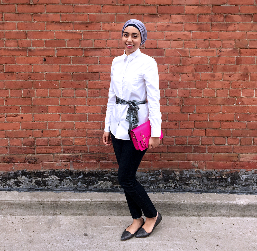 Fashionable work outfit with hot pink purse