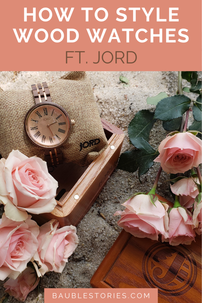 Jord Wood Watches Cassia flatlay with pink roses and wooden box in beach sand.