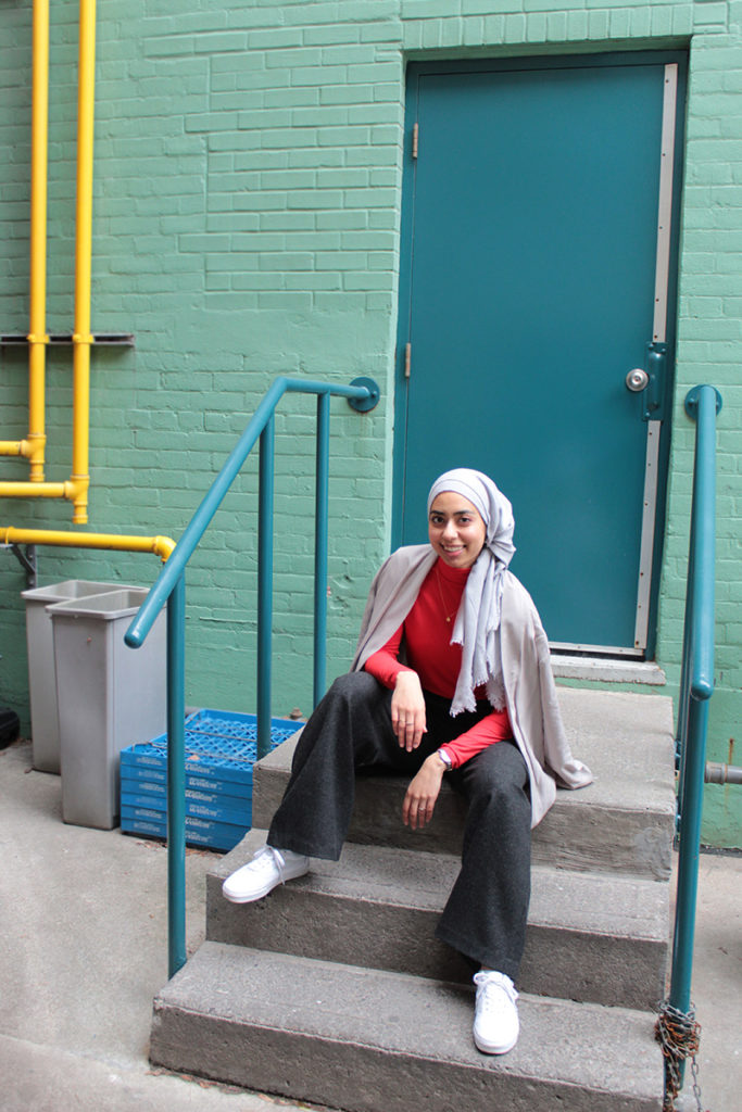 Living Coral - Pantone Colour Of The Year Coral and Grey Outfit By Hijabi Blogger Against Brick Wall